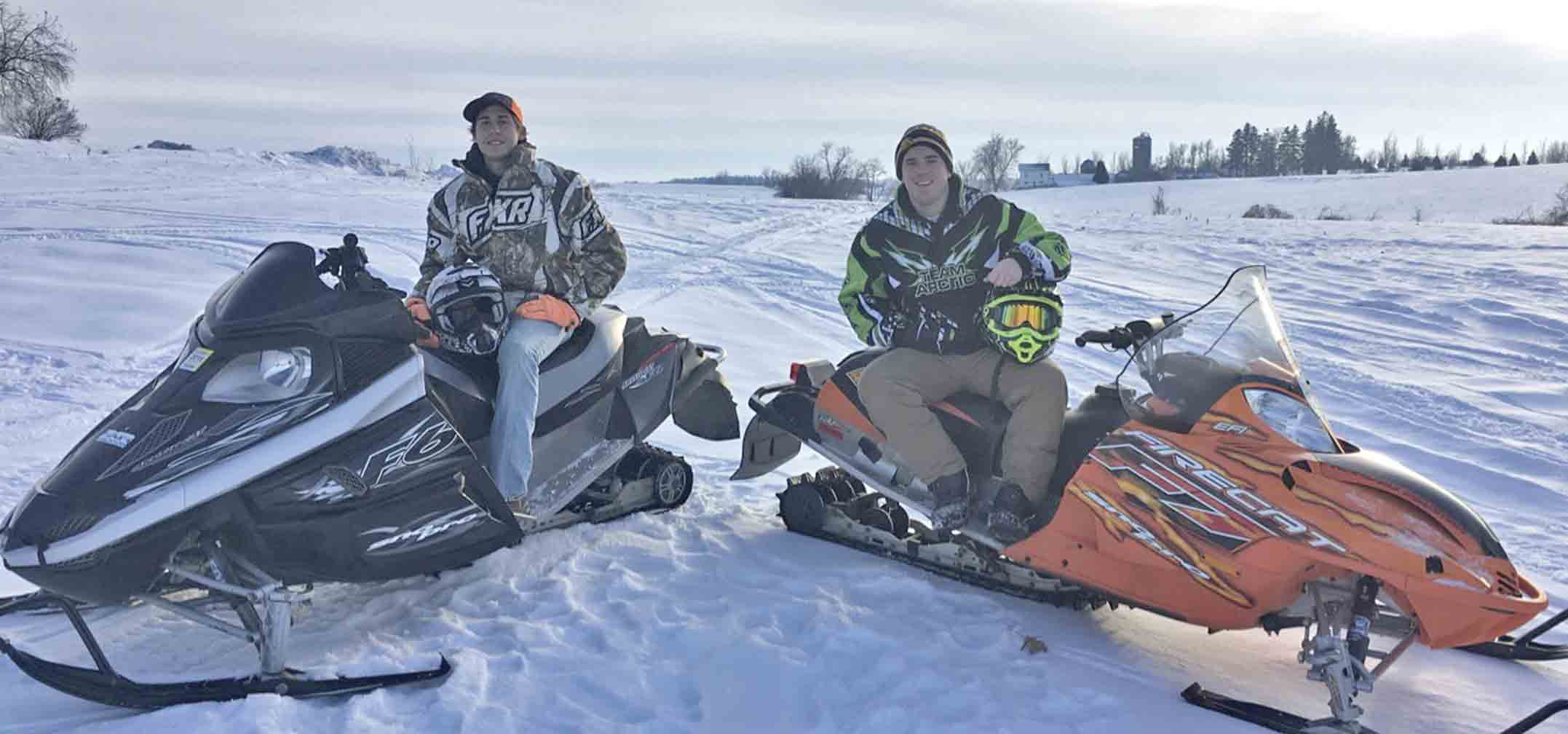 For cousins Blake and Tanner Kuennen (l-r), snowmobiling has become one of their favorite outdoor winter activities. Riding upwards of 100 miles per day, the two locals take their sleds out for a ride every opportunity they get throughout the winter months. (submitted photo)...