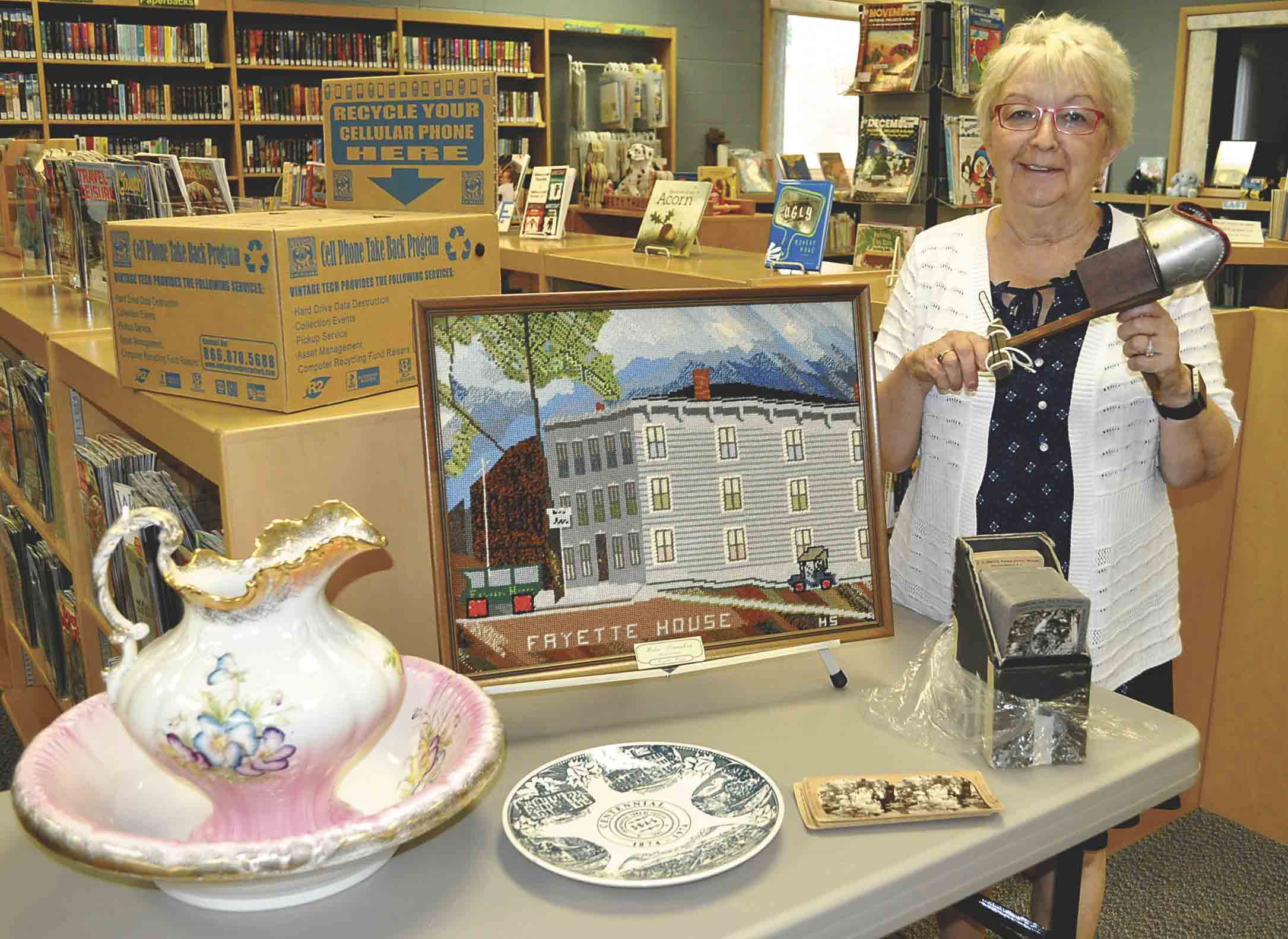 Fayette librarian Linda Adams is holding a stereoscope that was among the items donated to the city by Myrna Humiston Schultz of Fallon, Nev. Myrna is the granddaughter of E.N. Humiston, proprietor of the Fayette House, a hotel in the city that was a landmark in the late 1800s and...