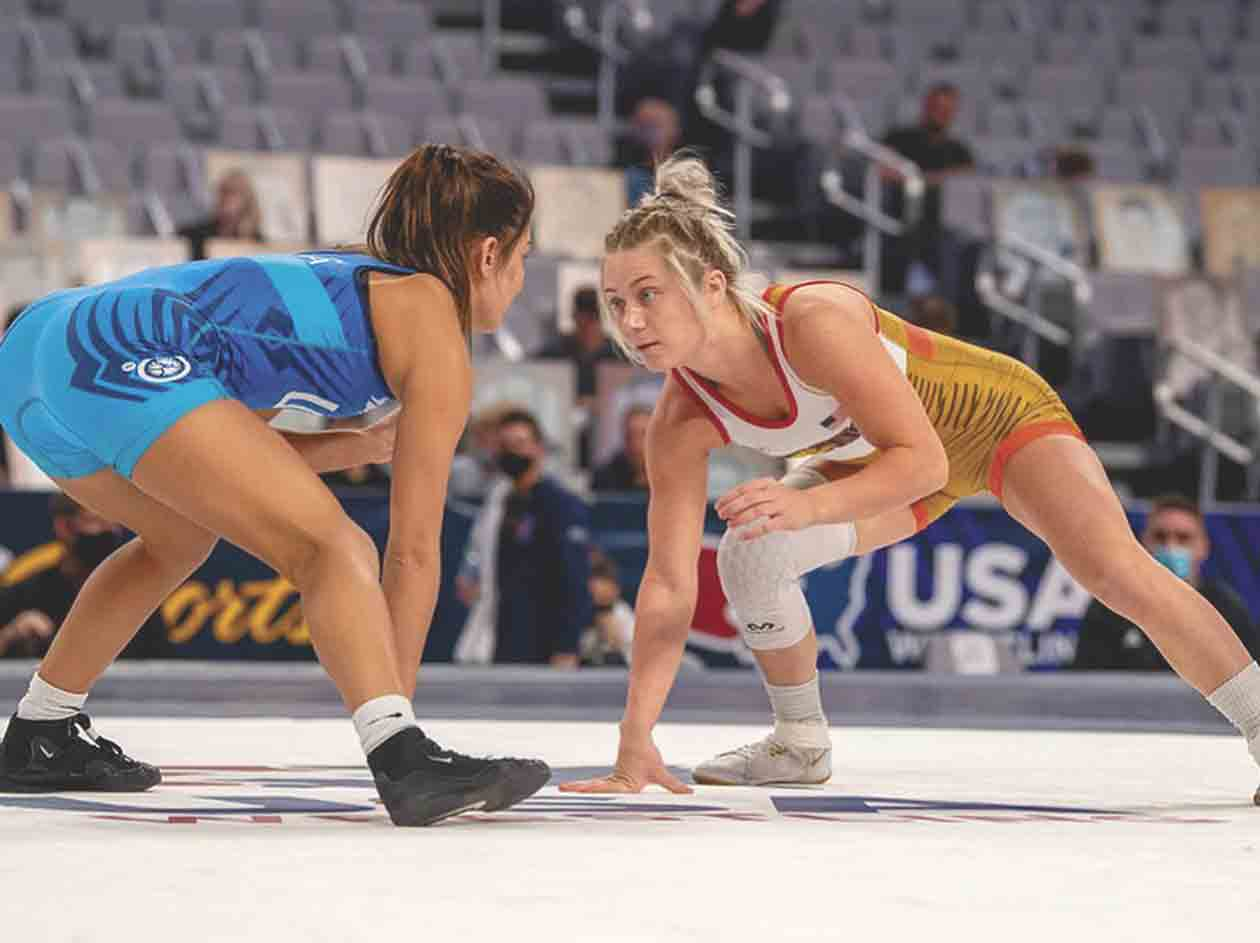 Felicity Taylor (right), a South Winneshiek alum and current wrestler for the McKendree women's wrestling team, goes head-to-head with a competitor at the USA Wrestling Olympic Team Trials recently. (photo by Jim Thrall)  	Continuing her mission to grow female wrestling...