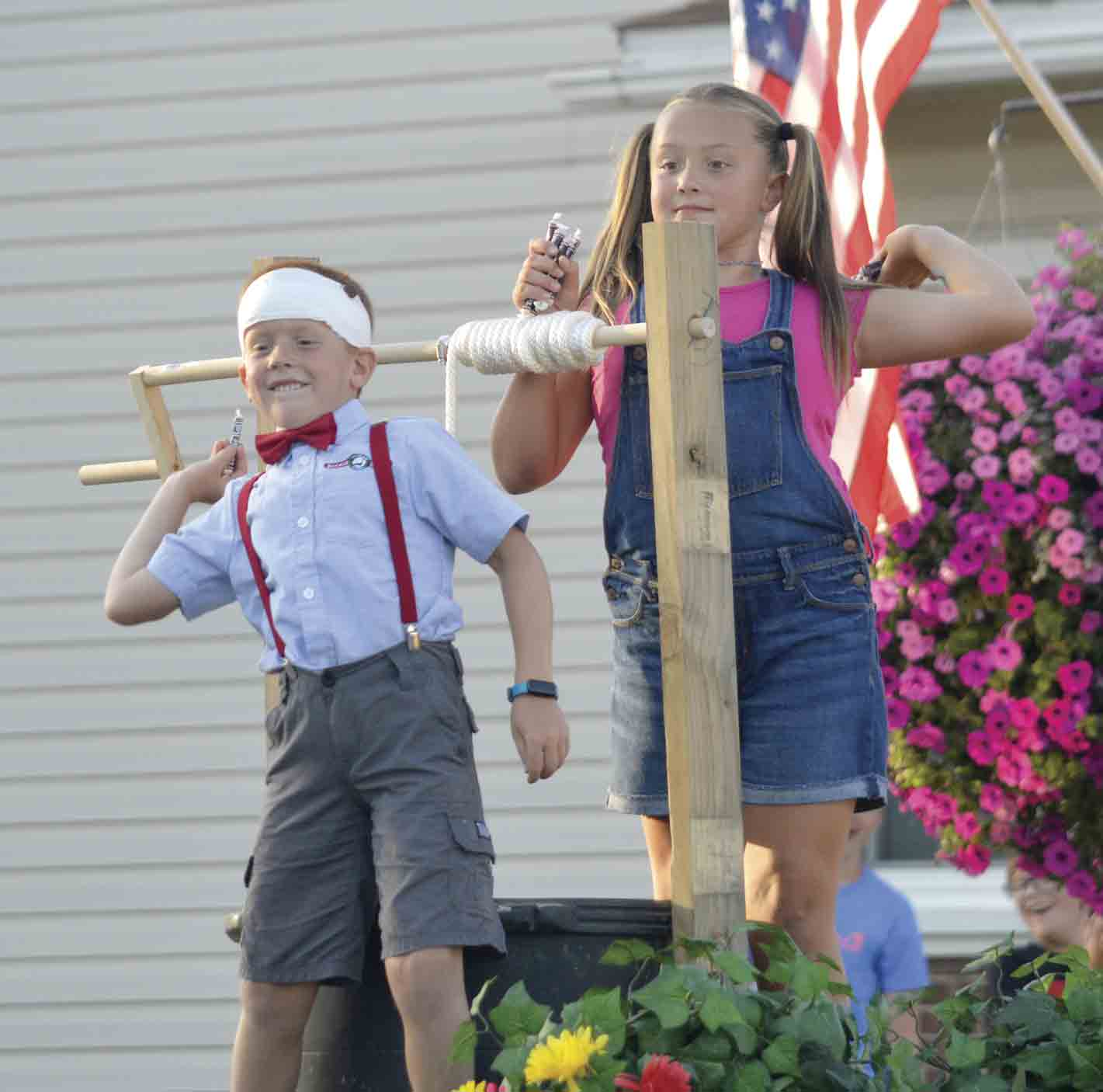 """Jack and Jill toss out some candy to parade goers at the 2019 Ossian Fest Grand Parade, which had the theme of """"It's Rhyme Time in Ossian."""" This year's Grand Parade will be held Saturday night, Aug. 7, with the theme of """"Golden Books Come to Ossian Fest."""" (Zakary..."""