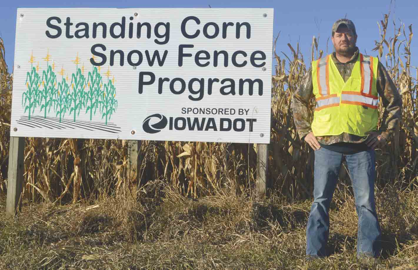 oel Monroe, Iowa Department of Transportation highway maintenance supervisor, points out one of the local standing-corn snow fences utilized throughout northeast Iowa to minimize blowing and drifting snow on adjacent roadways. (Zakary Kriener photo) 	Iowa DOT promoting standing-...