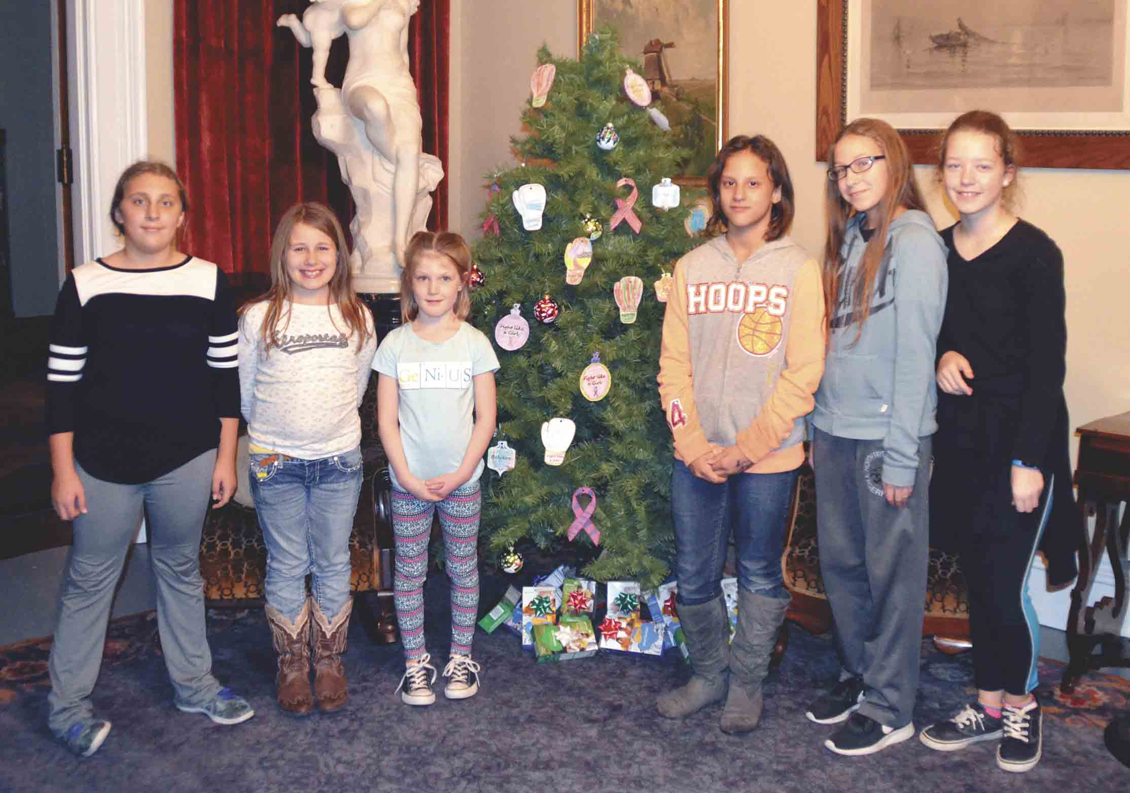 Scouts from Clermont, Elgin, and Wadena Cadet Troop 6044; Clermont, Elgin, and Wadena Daisy, Brownie, and Junior Troop 6038; and West Union Daisy and Brownie Troop 1873, including (l-r) Shae Moncada, Adeda Usher, Layla Schott, Juliana Muxin, Rachel Everman, and Allison Garlow, help decorate...