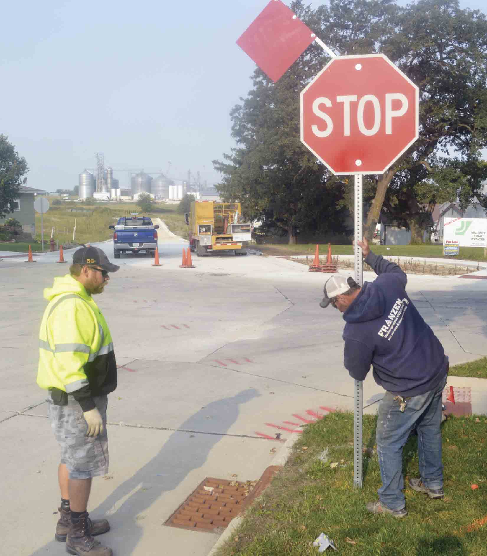 A new four-way stop was established at the intersection of Brooks and Jessie streets in Ossian last week. The new signage was installed Wednesday morning (Sept. 16) by Adam Brincks, Winneshiek County sign technician (left); and City of Ossian maintenance workers Brian Zweibohmer (pictured) and Don...