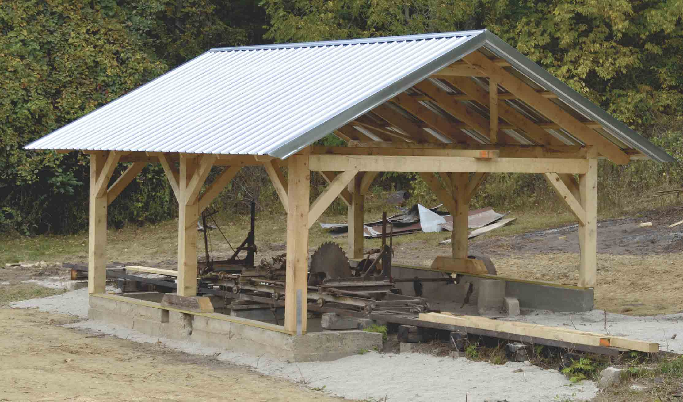 An old sawmill located at Gilbertson Park in Elgin has a new roof over its head after Fayette County Conservation worked with Dale Kittleson, owner of Wild Rose Timberworks in Decorah, to build a timber-frame shelter for the mill. (Chris DeBack photo) 	Old-time technique used to...
