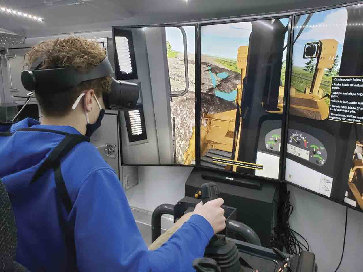 A young student gets to experience what it's like to be at the helm of a piece of heavy construction equipment through a virtual reality simulator. The simulator is used as part of the Northeast Iowa Community College Construction Equipment Operator Earn and Learn course, which is offered in...