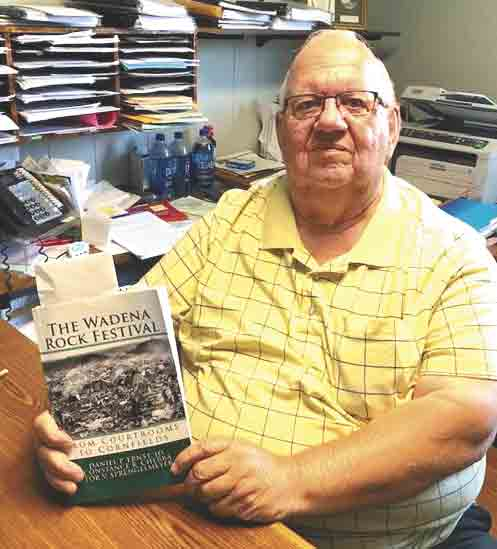 """""""Barney"""" G. W. Bond was 21 when the Wadena Rock Festival took place in his hometown. He is shown here with a copy of book """"The Wadena Rock Festival: From Courtrooms to Cornfields."""" Barney was at the festival for all three days. (Jack Swanson photos)July 31 marks..."""