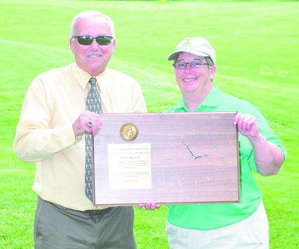 Before the start of the 2013 Girls' State Golf Meet, Valley's Robin Madole (r) was presented with the Golden Plaque of Distinction by IGHSAU Executive Director Mike Dick. In her 20 years as the Valley golf coach, the school has garnered seven UIC championships and made five State appearances.  Madole is the only golf coach the school has had in its 20 years. (Becky Walz photo)